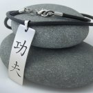 Kung fu Chinese martial Art stainless steel pendant on natural leather cord. A surfer style necklace
