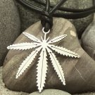 Cannabis stainless steel pendant on natural leather cord.               A surfer style necklace
