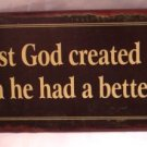 First God created man, then He had a better idea TIN SIGN