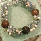 Multi gemstones and freshwater cultured white pearls in sterling sliver bracelet. 9''