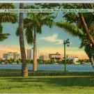 Linen Postcard. A Tropical setting showing skyline. West Palm Beach, Florida