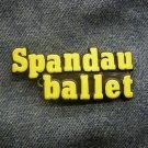 SPANDAU BALLET PLASTIC PIN yellow logo VINTAGE
