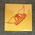 AEROSMITH PINBACK BUTTON yellow/red wings logo square VINTAGE