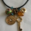 Charm Necklace: key, beads, chinese coin, enamel charm