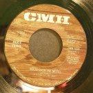 MERLE TRAVIS~Moon Over the Motel~CMH 1525 Rare 45