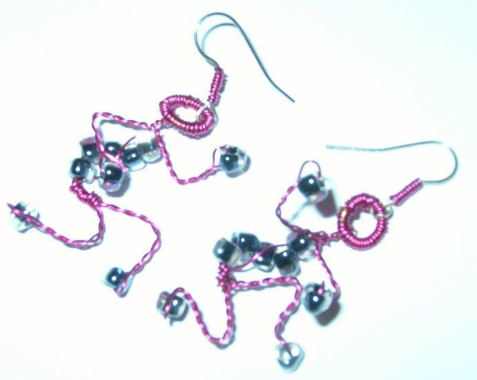 Pink adjustable figure earrings