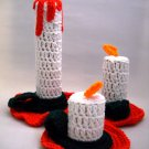 3 hand crocheted candles