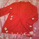 The orange cardigan