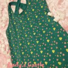 The green dotted vest