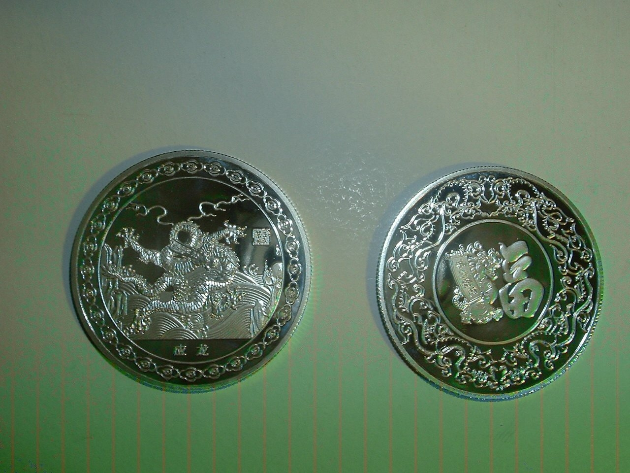 2011  #3 Year of the Dragon Silver Coin