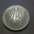 1943 #12 Unc.  Mexican Un Peso Silver Dollar.