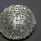 1944 #4 Unc.  Mexican Un Peso Silver Dollar.