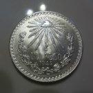 1944 #5 Unc.  Mexican Un Peso Silver Dollar.