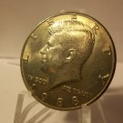 1988-D #1 Kennedy Half Dollar with  Bronze Hue  toning on obv.