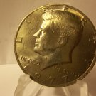 1977-P #2 Kennedy Half Dollar with  Bronze and Blue  toning on obv.