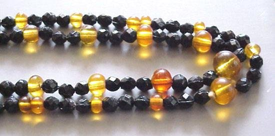 Long Vintage Art Deco Faceted Black and Amber Glass Beads