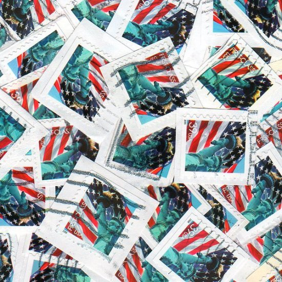 100 USA Used Lady Liberty and Flag postage stamps on paper bundle bundleware