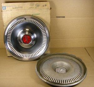 79 81 Pontiac Fullsize w/ deluxe cover NOS hubcap pair