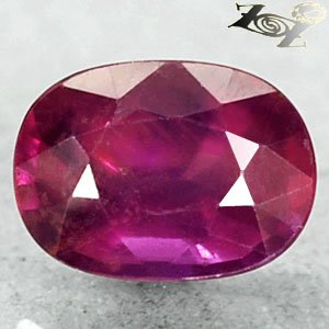 Strange Unheated Natural Oval 6*7 mm. Labradorescnec Red Pink Sapphire 1.3 Ct.