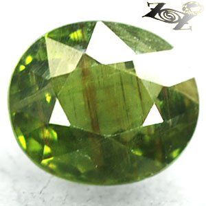 4.72 CT.Natural Oval 9*11 mm.Red Brown Rutiles Inside Green Mada Apatite 綠�磷��