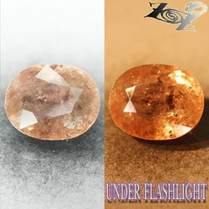 6.75 CT.Natural Oval 10*13 mm. Color Shift Intense Lilac Brown Ferro Axinite Gem