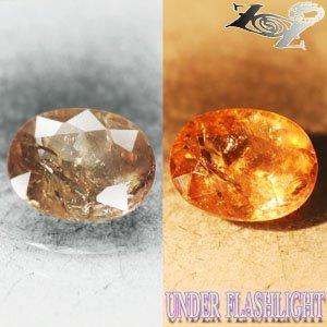3.28 CT.Natural Oval 8*11 mm. Intense Lilac Salmon Peach Clr Shift Ferro Axinite