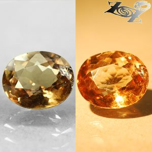 4.01 Ct.Full Fire Natural Oval 9*10.5 mm. Color Shift Yellow Brown Ferro Axenite