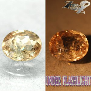 2.38 CT.Firely Natural Oval 7*9 mm. Intense Lilac Yellow France Ferro Axinite