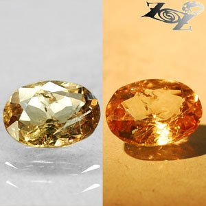 2.51 Ct.Natural Oval 8*10 mm. Color Shift Intense Yellow France Ferro Axinite