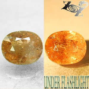 6.69 CT.Natural Oval 10*12 mm. Intense Salmon Yellow Color Shift Ferro Axinite