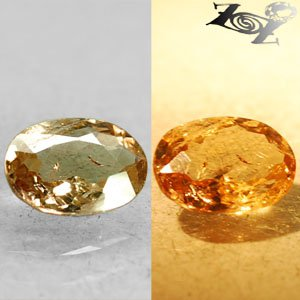 2.3 Ct.Natural Oval 8*10 mm. Color Shift Intense Salmon Yellow Ferro Axinite Gem