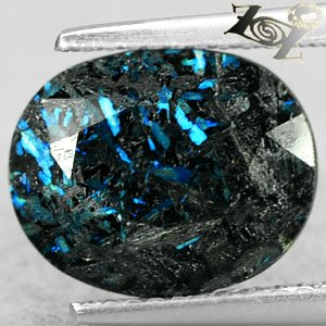 4.04 Ct.Natural Oval 9*13 mm. Titanium Blue Scheen Streaks Jenakite Nummite