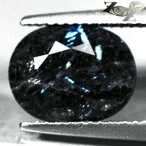 3.34 CT.Natural Oval 9*11 mm. Titanium Blue Schiller Streaks Jenakite Nuummite