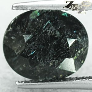 4.3 CT.Natural Oval 9.5*11 mm. Green Yellow Schiller Streaks Mauritania Nuummite