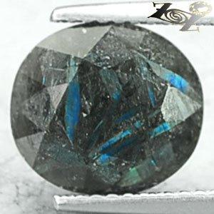 3.64 CT.Natural Oval 9.5*10.5 mm. Titanium Blue Scheen Streaks Nuummite Jenakite