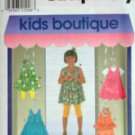 SIMPLICITY 7991 GIRLS' DRESS OR TUNIC, TOP, SHORTS. HEADBAND & KNIT LEGGINS