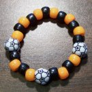 Acrylic Black & Orange Soccer Ball Sport Stretch Bracelet 5.5""