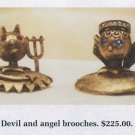 Tortolani devil and angel shoulder pins