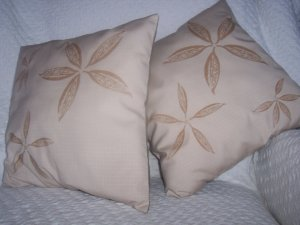 pair taupe cushions with native design by Gina