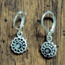 Silver delicate pattern earrings with black stones