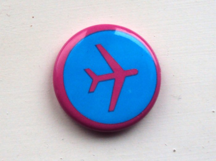 Bright pink and blue airplane pin