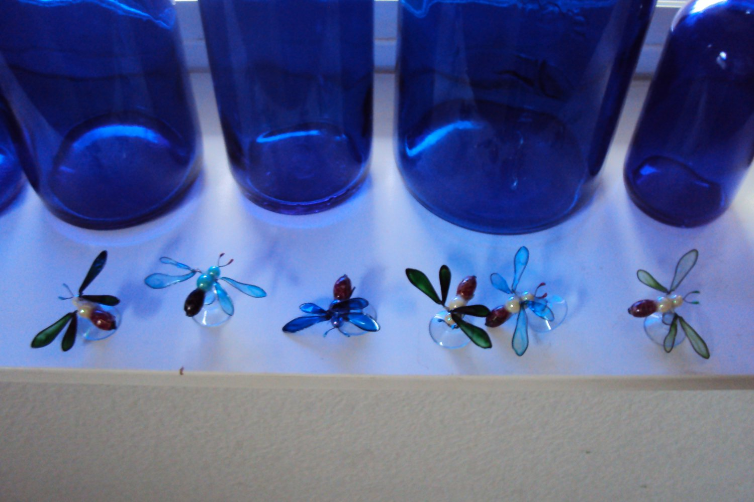 Beaded and stained glass window bugs