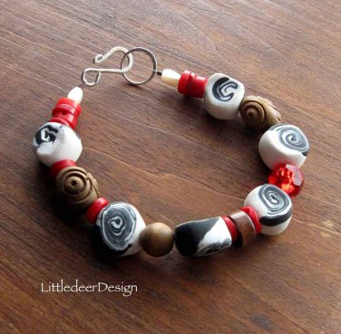 Handmade poly clay taffy beads, vintage wood, and coral bracelet