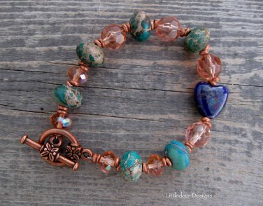 Handmade turquoise jasper with pink champagne glass and acrylic beads and copper bracelet