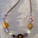 Handmade Rainbow Fluorite nugget with sliced nut bead necklace
