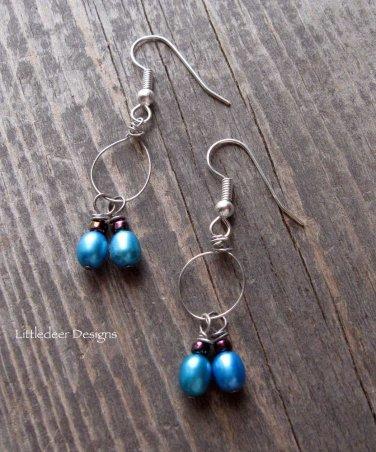 Handmade electric blue pearl earrings on silver earwires
