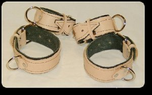Wrist and Ankle Cuffs Tan Leather On Black Leather Roller Buckle  (set of 4)