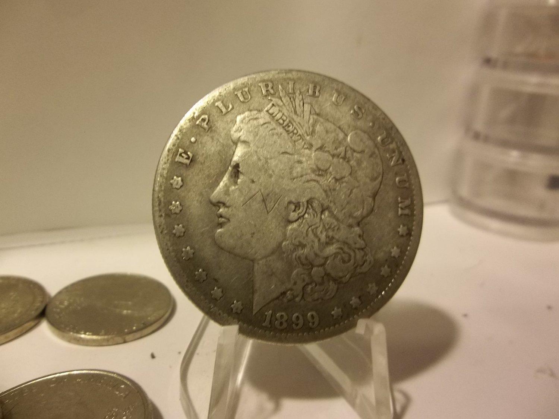 1899-O #4 90% Silver Morgan Dollar.