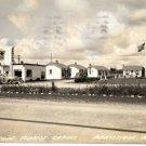 Manistique Michigan Postcard, Tourist Cabins & Mobil Station, Black & White Real Photo c.1941