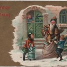 Christmas Postcard, Children with Santa in Brown Robe with Bag of Toys, Embossed c.1910